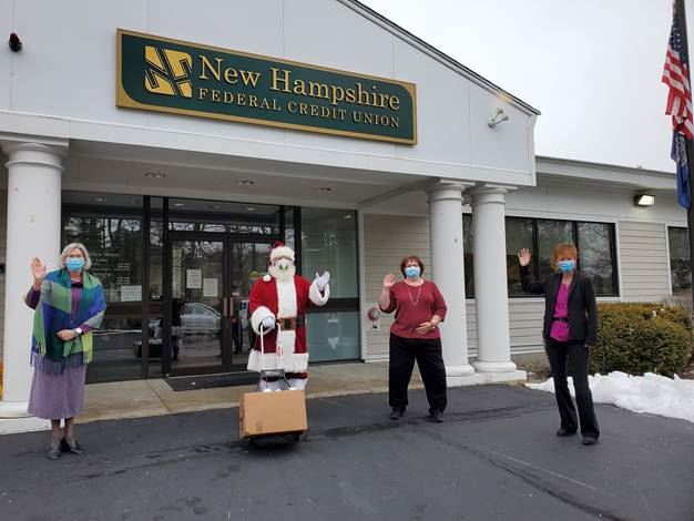 L to R, LuAnn Chapman, Santa, Karen Murphy and Carolyn Allhiser hand off Donations to Santa